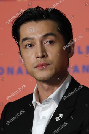Stock Picture of Hu Ge attends the press conference for â??Nan Fang Che Zhan De Ju Hui' (The Wild Goose Lake) during the 72nd annual Cannes Film Festival, in Cannes, France, 19 May 2019. The movie is presented in the Official Competition of the festival which runs from 14 to 25 May.