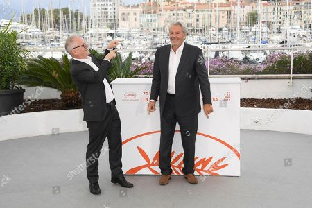Thierry Fremaux, Alain Delon. Festival director Thierry Fremaux, left, poses with actor Alain Delon for photographers at the photo call for Delon's honorary Palme D'Or award at the 72nd international film festival, Cannes, southern France