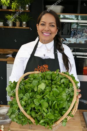 Stock Photo of Shelina Permalloo, Masterchef winner and proprietor of Lakaz Maman gives a cooking demonstration at the festival