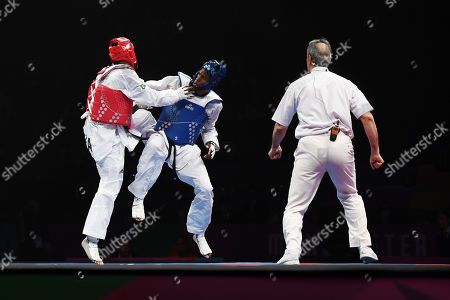 Stock Photo of Rafael Alba of Cuba competes against of Maicon Siquera of Brazil in the Semi Final of the Mens 87kg Fight.