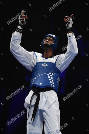 Rafael Alba of Cuba competes against of Maicon Siquera of Brazil in the Semi Final of the Mens 87kg Fight.