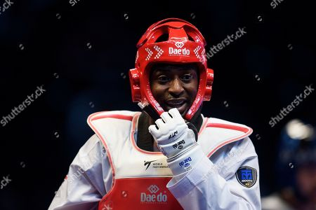 Mahama Cho of Great Britain during his round of 16 Fight against Marc Andre Bergeron of Canada.