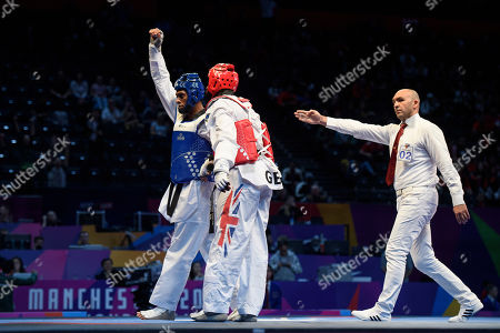 Maicon Siqueira celebrates after beating Mahama Cho of Great Britain during the Mens 87kg Quarter final fight.