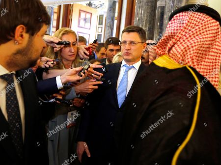 Stock Image of Russian Minister of Energy Alexander Novak is surrounded by reporters as he arrives to attend a meeting of the energy ministers from OPEC and its allies to discuss prices and production cuts, in Jiddah, Saudi Arabia, . The meeting takes places as tensions flare in the Persian Gulf after the U.S. ordered bombers and an aircraft carrier to the region over an unexplained threat they perceive from Iran, which comes a year after the U.S. unilaterally pulled out of Tehran's nuclear deal with world powers and reimposed sanctions on Iranian oil