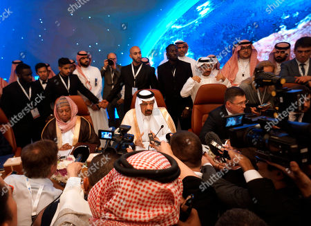 Alexander Novak, Khalid al-Falih, Mohammed Sanusi Barkindo. Russian Minister of Energy Alexander Novak, center right, Saudi Minister of Energy, Industry and Mineral Resources Khalid al-Falih, center, and OPEC Secretary General, Mohammed Sanusi Barkindo, center left, are surrounded by reporters during the opening of a meeting of energy ministers from OPEC and its allies to discuss prices and production cuts, in Jiddah, Saudi Arabia, . The meeting takes places as tensions flare in the Persian Gulf after the U.S. ordered bombers and an aircraft carrier to the region over an unexplained threat they perceive from Iran, which comes a year after the U.S. unilaterally pulled out of Tehran's nuclear deal with world powers and reimposed sanctions on Iranian oil