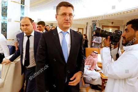 Russian Minister of Energy Alexander Novak arrives to attend a meeting of the energy ministers from OPEC and its allies to discuss prices and production cuts, in Jiddah, Saudi Arabia, . The meeting takes places as tensions flare in the Persian Gulf after the U.S. ordered bombers and an aircraft carrier to the region over an unexplained threat they perceive from Iran, which comes a year after the U.S. unilaterally pulled out of Tehran's nuclear deal with world powers and reimposed sanctions on Iranian oil