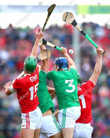 Limerick vs Cork. Cork's Aidan Walsh and Seamus Harnedy with Dan Morrissey and Mike Casey of Limerick
