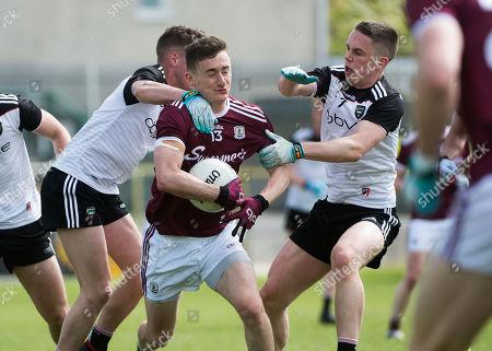 Sligo vs Galway. Sligo's Michael Gordon and Paul Mc Namara with Antaine Ó Laoi of Galway