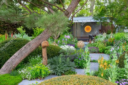 The Morgan Stanley Garden, Designed by Chris Beardshaw. Final preparations by Exhibitors at RHS Chelsea before the visit of HRH Elizabeth the second on Monday 20th May.