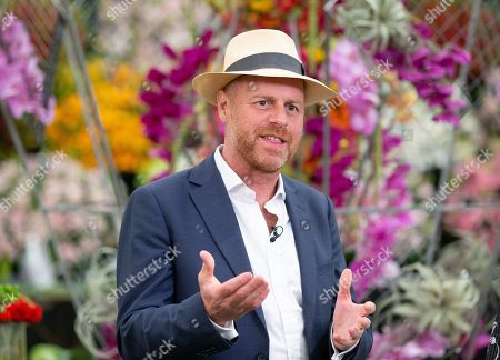 Joe Swift, English garden designer, journalist and television presenter. Final preparations by Exhibitors at RHS Chelsea before the visit of HRH Elizabeth the second on Monday 20th May.