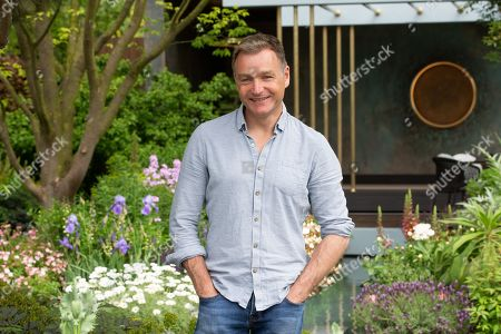 Garden Designer, Chris Beardshaw, designer of The Morgan Stanley Garden. Final preparations by Exhibitors at RHS Chelsea before the visit of HRH Elizabeth the second on Monday 20th May.