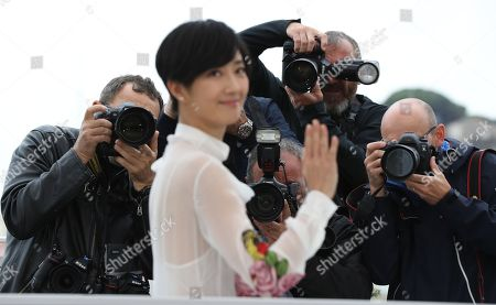 Stock Picture of Photographers take a picture of Gwei Lun Mei