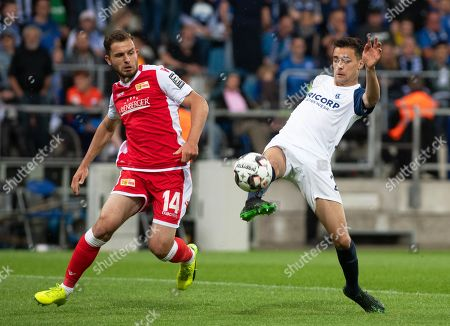 Bochum's Milos Pantovic (R) in action against Union's Ken Reichel  (L) during the German Bundesliga second division soccer match between VfL Bochum and FC Union Berlin in Bochum, Germany, 19 May 2019.
