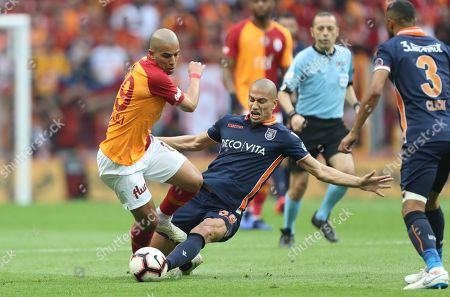 Galatasaray's Sofiane Feghouli (L) in action against Basaksehir's Gokhan Inler (R) at the Turkish Super League derby match between Galatasaray and Istanbul Basaksehir in Istanbul, Turkey 19 May 2019.