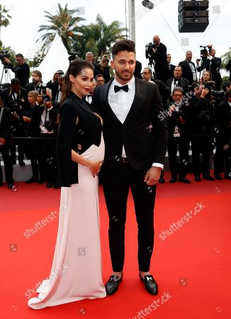 Nabilla Benattia (L) and her husband Thomas Vergara (R) arrive for the screening of 'A Hidden Life' during the 72nd annual Cannes Film Festival, in Cannes, France, 19 May 2019. The movie is presented in the Official Competition of the festival which runs from 14 to 25 May.