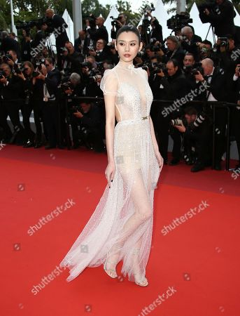 Ming Xi poses for photographers upon arrival at the premiere of the film 'A Hidden Life' at the 72nd international film festival, Cannes, southern France