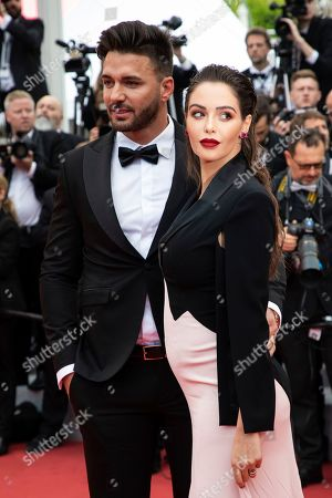 Stock Photo of Thomas Vergara, Nabilla Benattia. Thomas Vergara, left, and Nabilla Benattia pose for photographers upon arrival at the premiere of the film 'A Hidden Life' at the 72nd international film festival, Cannes, southern France
