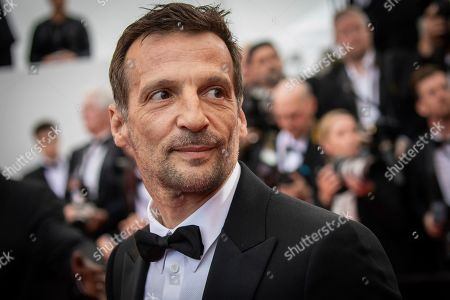 Mathieu Kassovitz poses for photographers upon arrival at the premiere of the film 'A Hidden Life' at the 72nd international film festival, Cannes, southern France