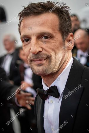 Stock Photo of Mathieu Kassovitz poses for photographers upon arrival at the premiere of the film 'A Hidden Life' at the 72nd international film festival, Cannes, southern France