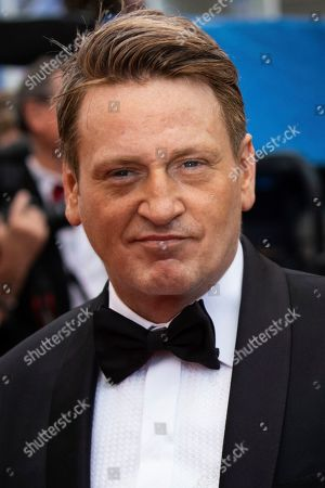 Benoit Magimel poses for photographers upon arrival at the premiere of the film 'A Hidden Life' at the 72nd international film festival, Cannes, southern France