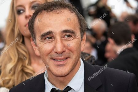 Elie Semoun poses for photographers upon arrival at the premiere of the film 'A Hidden Life' at the 72nd international film festival, Cannes, southern France