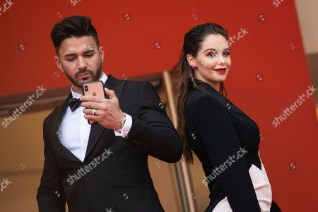 Stock Image of Thomas Vergara, Nabilla Benattia. Thomas Vergara, left, and Nabilla Benattia pose for photographers upon arrival at the premiere of the film 'A Hidden Life' at the 72nd international film festival, Cannes, southern France