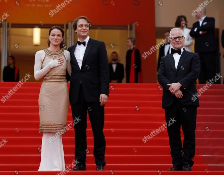 August Diehl, Valerie Pachner, Thierry Fremaux. Actors August Diehl, centre, Valerie Pachner and festival director Thierry Fremaux pose for photographers upon arrival at the premiere of the film 'A Hidden Life' at the 72nd international film festival, Cannes, southern France