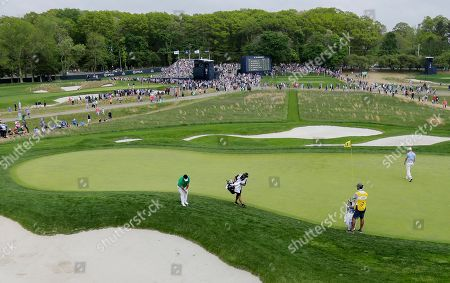 Kiradech Aphibarnrat of Thailand putts on the 17th green during the final round of the PGA Championship golf tournament, at Bethpage Black in Farmingdale, N.Y