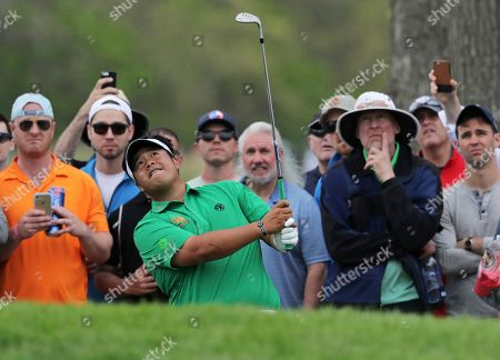 Kiradech Aphibarnrat of Thailand chips onto the ninth green during the final round of the PGA Championship golf tournament, at Bethpage Black in Farmingdale, N.Y