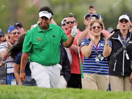 Kiradech Aphibarnrat of Thailand reacts after chipping into the ninth hole during the final round of the PGA Championship golf tournament, at Bethpage Black in Farmingdale, N.Y