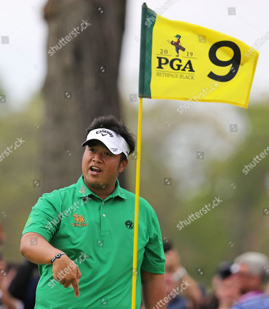 Kiradech Aphibarnrat of Thailand asks the crowd if his chip out of the rough went directly into the hole on the ninth green during the final round of the PGA Championship golf tournament, at Bethpage Black in Farmingdale, N.Y