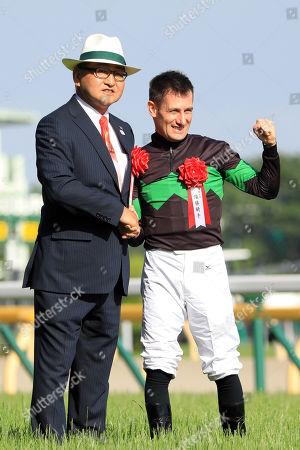 , Tokyo, Japan, Portrait of trainer Yoshito Yahagi and jockey Mirco Demuro at Fuchu racecourse.