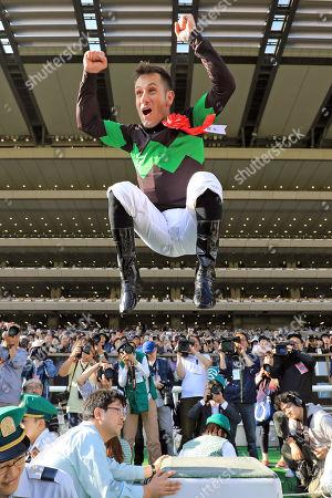 , Tokyo, Japan, Jockey Mirco Demuro celebrates at winners presentation after winning the Yushun Himba (Japanese Oaks) at Fuchu racecourse.