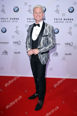 Guido Cantz poses on the red carpet for the Felix Burda Award in Berlin, Germany, 19 May 2019.