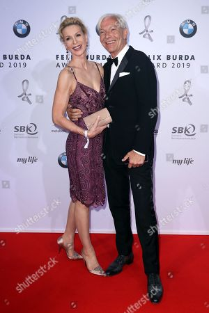 Stock Image of Jo Groebel (R) and Gattin Grit Weiss (L) pose on the red carpet for the Felix Burda Award in Berlin, Germany, 19 May 2019.