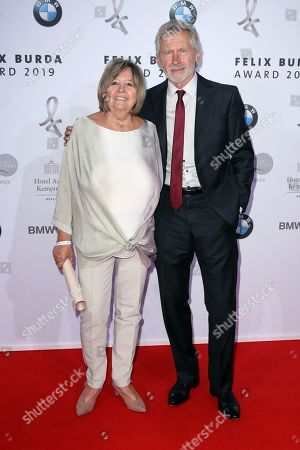 Paul Breitner (R) and his wife Hildegard Breitner (L) pose on the red carpet for the Felix Burda Award in Berlin, Germany, 19 May 2019.