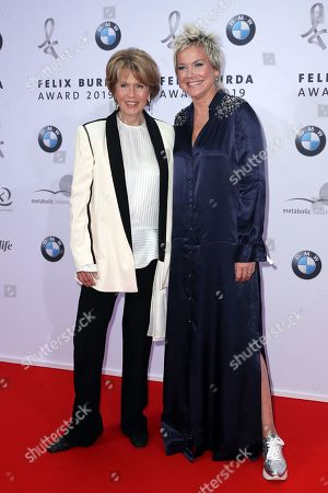 Stock Picture of Christa Maar (L) and Inka Bause (R) pose on the red carpet for the Felix Burda Award in Berlin, Germany, 19 May 2019.