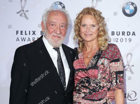 Dieter Hallervorden (L) and Christiane Zander pose on the red carpet for the Felix Burda Award in Berlin, Germany, 19 May 2019.