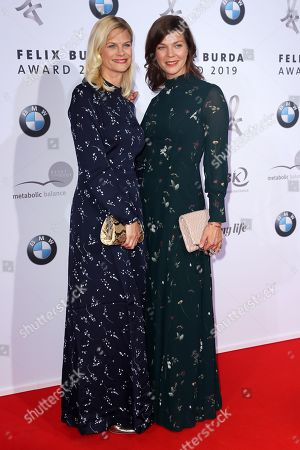 Jessica Schwarz (R) and her sister Sandra Schwarz pose on the red carpet for the Felix Burda Award in Berlin, Germany, 19 May 2019.