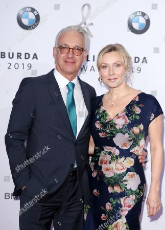 Christoph M. Ohrt (L) and his wife Stevee M. Ohrt pose on the red carpet for the Felix Burda Award in Berlin, Germany, 19 May 2019.