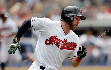 Stock Picture of Cleveland Indians' Mike Freeman runs the bases after hitting a two-run double off Baltimore Orioles relief pitcher Gabriel Ynoa in the seventh inning of a baseball game, in Cleveland. Leonys Martin and Oscar Mercado scored on the play