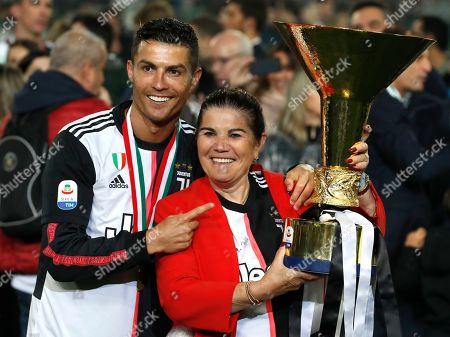 Juventus' Cristiano Ronaldo poses with his mother Dolores Aveiro, right, after winning the Serie A soccer title trophy, at the Allianz Stadium, in Turin, Italy