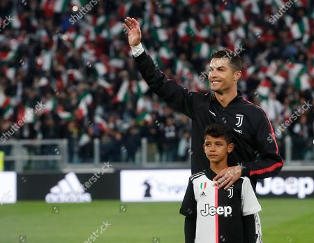 Juventus' Cristiano Ronaldo with his son Cristiano Jr prior to the Serie A soccer match between Juventus and Atalanta at the Allianz stadium, in Turin, Italy