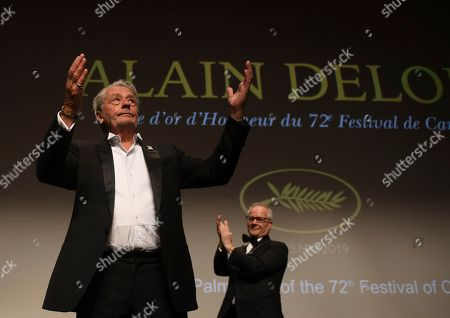 Alain Delon, Thierry Fremaux. Actor Alain Delon accepts applause prior to receiving his honorary Palme D'Or award from festival director Thierry Fremaux, back, at the 72nd international film festival, Cannes, southern France
