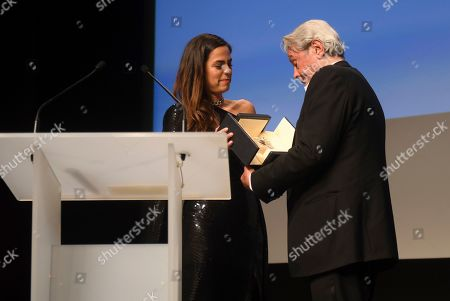 Anouchka Delon, Alain Delon. Anouchka Delon, left, speaks at a ceremony to present the honorary Palme D'Or awarded to father Alain Delon at the 72nd international film festival, Cannes, southern France