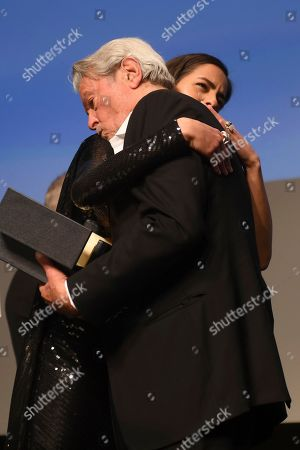 Anouchka Delon, Alain Delon. Anouchka Delon embraces her father, Alain Delon during a ceremony to present him with the honorary Palme D'Or award at the 72nd international film festival, Cannes, southern France