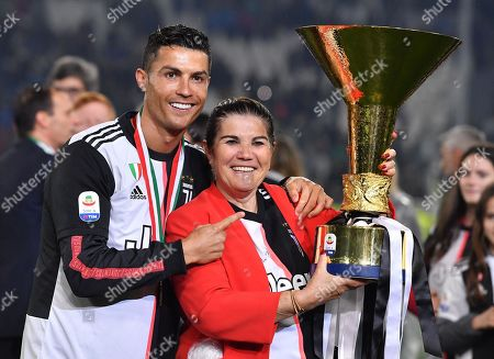 Juventus player Cristiano Ronaldo celebrates with his mother Maria Dolores dos Santos Aveiro holding the Serie A title trophy at the end of the Italian Serie A soccer match Juventus FC vs Atalanta BC at the Allianz Stadium in Turin, Italy, 19 May 2019.