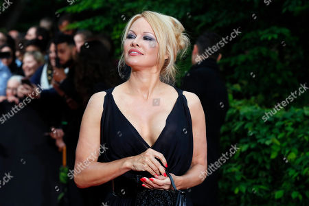 US actress Pamela Anderson arrives with Soccer player Adil Rami at the UNFP (Union of French Professional Footballers) ceremony, in Paris, France