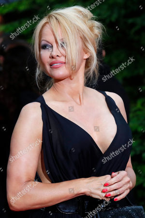 Stock Photo of US actress Pamela Anderson arrives with Soccer player Adil Rami at the UNFP (Union of French Professional Footballers) ceremony, in Paris, France