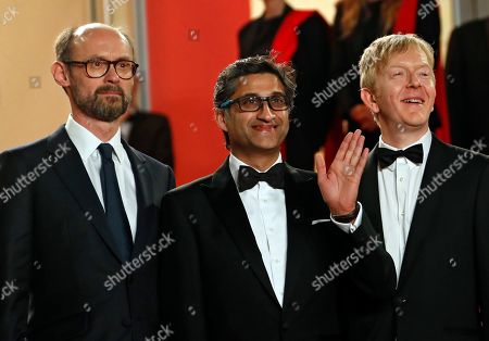 Asif Kapadia (C) arrives with film editor Chris King (R) and British producer James Gay-Rees (L) for the screening of 'Diego Maradona' during the 72nd annual Cannes Film Festival, in Cannes, France, 19 May 2019. The movie is presented out of competition at the festival which runs from 14 to 25 May.